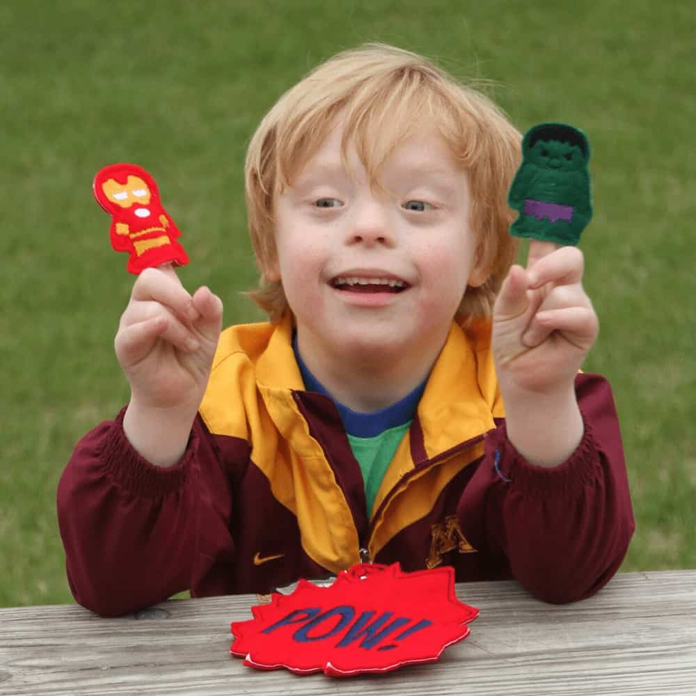 Imaginative play in action with a little boy using finger puppets to explore his imagination.