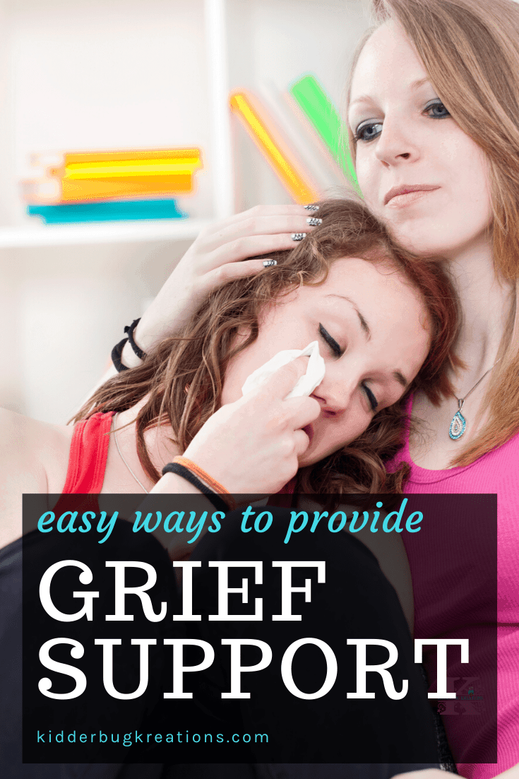 One woman providing grief support to a crying woman holding a tissue.