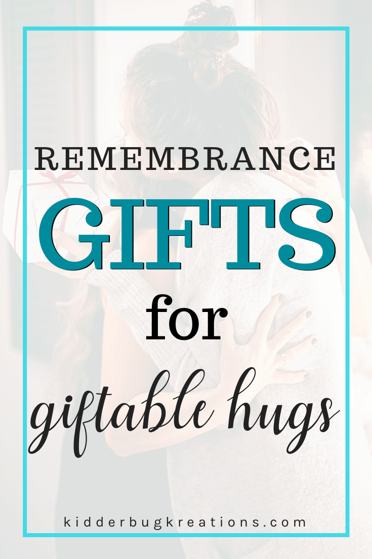 In the background are 2 women hugging with one holding a gift box and the words Remembrance Gifts is written on the photo.