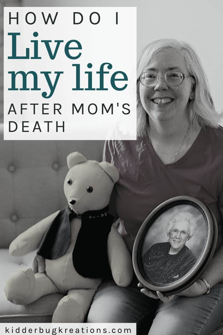 Woman holding a photo of her mother and a memory bear made from her mother's clothing after her mom passed away.