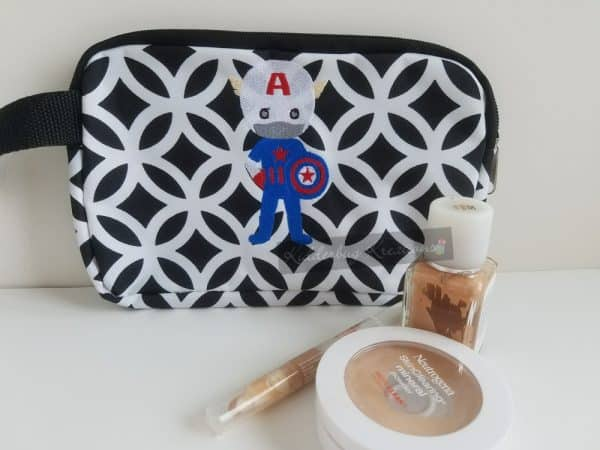 Cosmetic bag with american hero embroidered design