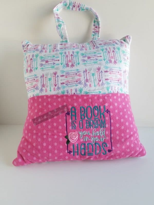 """""""A Book Is a Dream"""" (with arrows) Reading Pillow"""