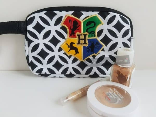 Cosmetic bag with HP embroidered design