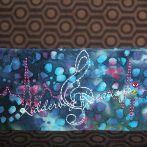 checkbook cover-treble clef