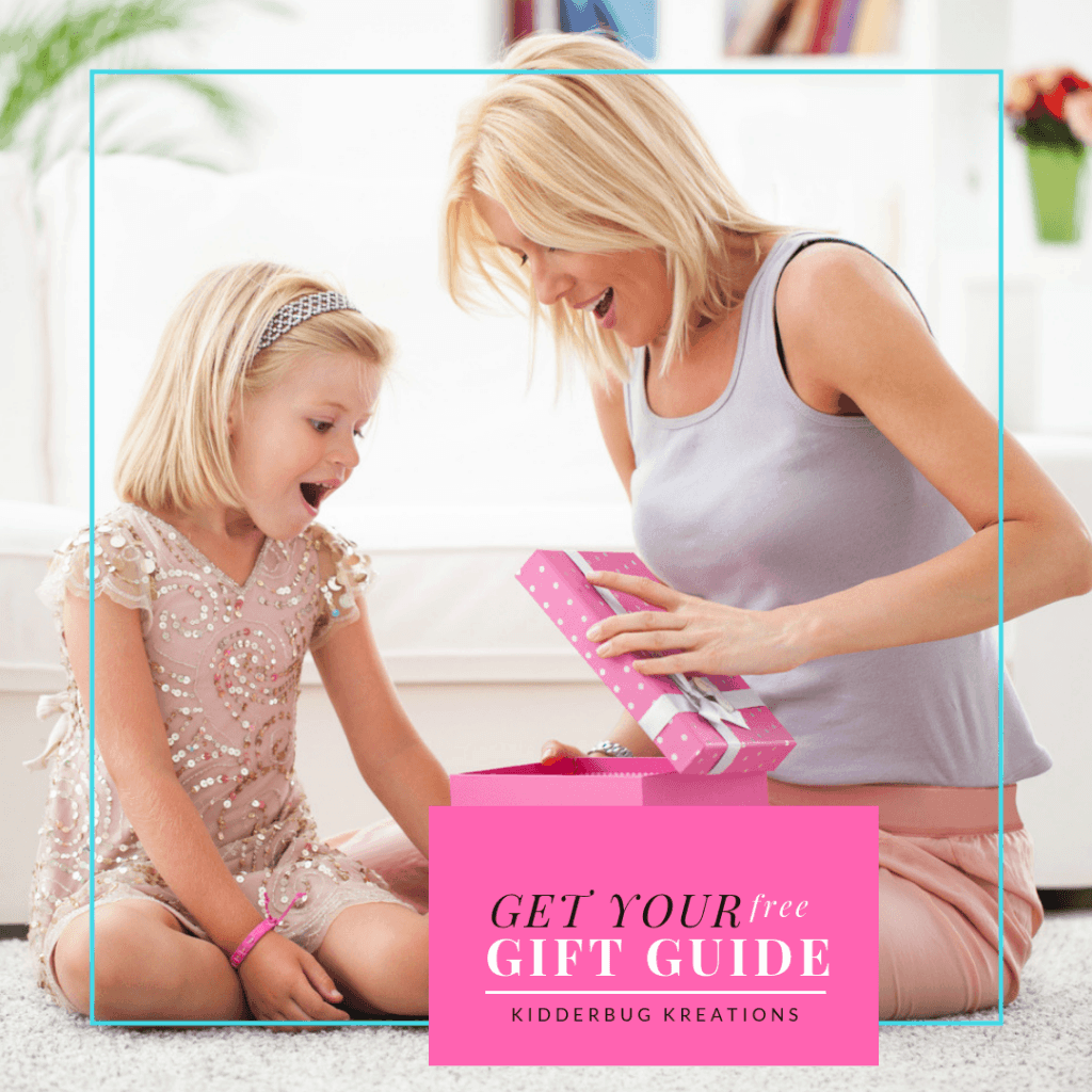 Surprised woman and girl opening pink gift box