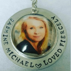 Memorial jewelry with photo as a gift for parents who have lost a child.