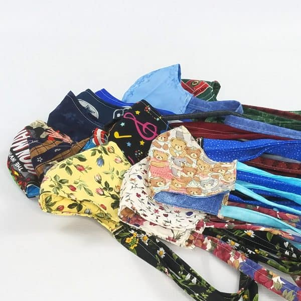cotton fabric face masks with ties and a pocket for a filter to help prevent the spread of germs.