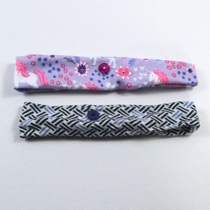Headband with buttons for nurses or others needing to wear face masks regularly.