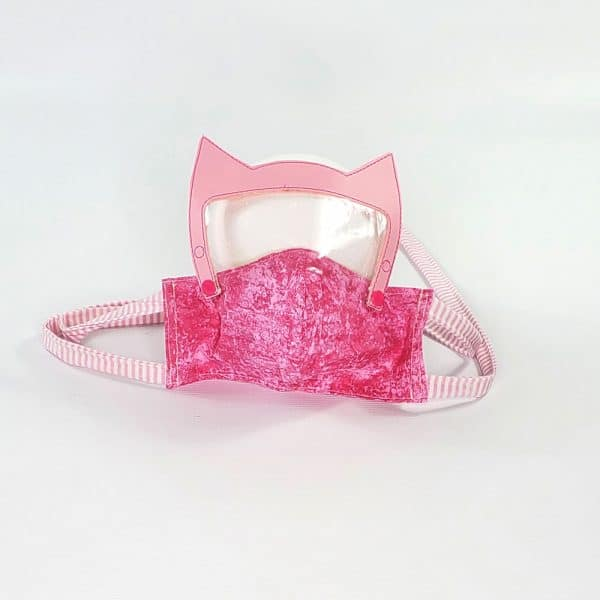 Fabric face mask with a removable pink bat hero face shield attachment. Made with a pocket for a filter and fabric ties.