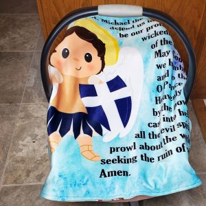 A St. Michael baby blanket featuring teals and purples and the St. Michael prayer is a perfect baby gift or Baptism gift.