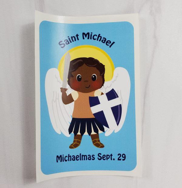 Saint Michael vinyl sticker from Kidderbug Kreations featuring a black skin tone St Michael with the words Michaelmas Sept. 29.