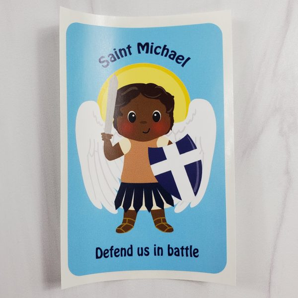 A vinyl sticker from Kidderbug Kreations featuring a black St Michael with the wording Saint Michael defend us in battle.