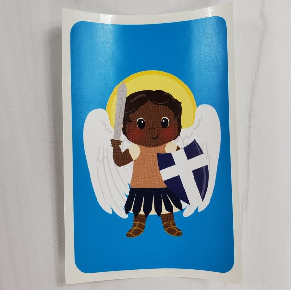 A vinyl sticker from Kidderbug Kreations featuring a black St Michael with a halo.