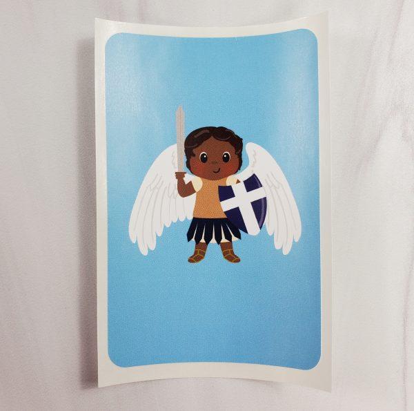 A vinyl sticker from Kidderbug Kreations featuring a black St Michael.