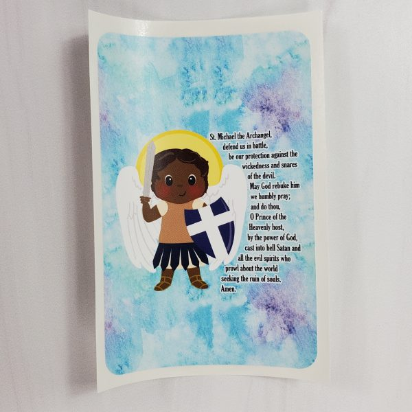 A vinyl sticker from Kidderbug Kreations featuring a black St Michael with his prayer.