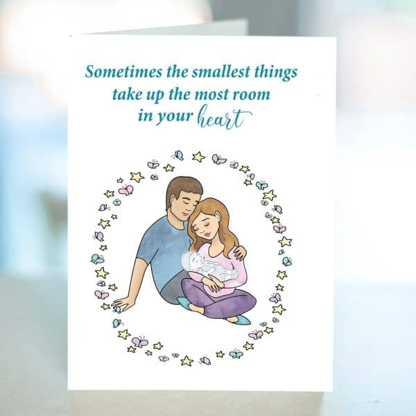 Miscarriage card with white parents holding a baby that appears transparent. Butterflies and stars surround the family.