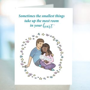 Miscarriage card with white dad & black mom with a baby that appears transparent. Butterflies and stars surround the family.