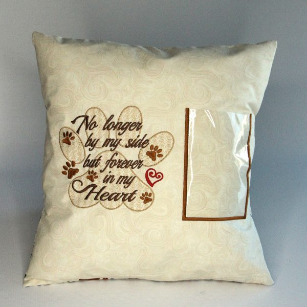 Pet loss memory pillow by Kidderbug Kreations is embroidered with No longer by my side and has a spot to insert a photo.