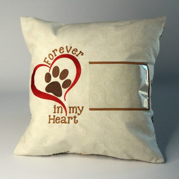 Pet loss memory pillow by Kidderbug Kreations is embroidered with Forever in my Heart and has a spot to insert a photo.