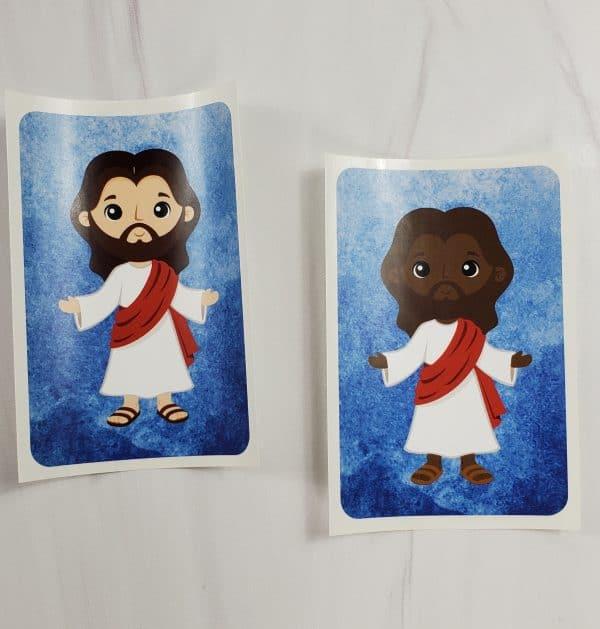Jesus vinyl sticker in both white skin tone and black skin tone.