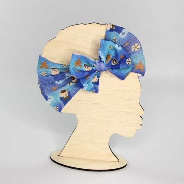 Star of the Sea, or Stella Maris headwrap bow, features Mary, starfish, and sand dollars. The perfect gift for any little girl.