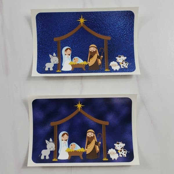 Nativity vinyl stickers with a blue metallic foil background or a blue cloudy looking background.