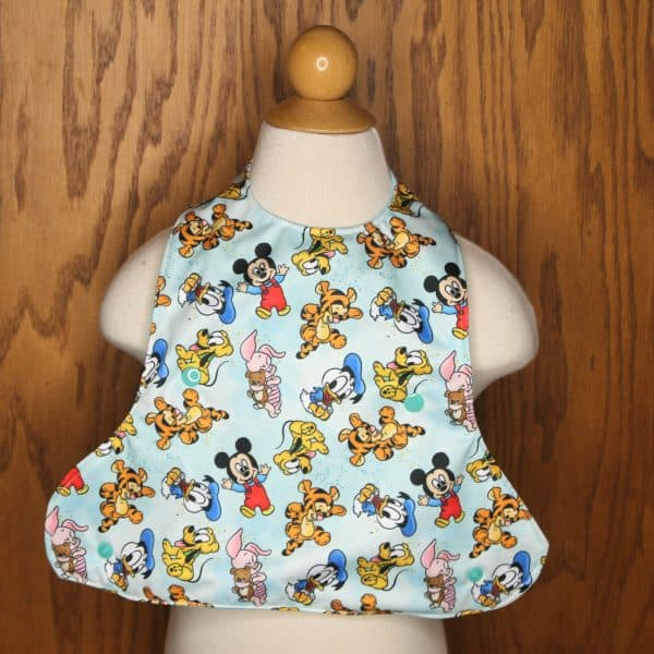 Cartoon babies on an adorable baby bib crumb catcher that keeps baby clean during mealtime.