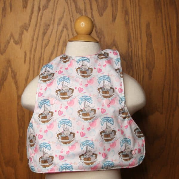 Bathing elephant on an adorable baby bib crumb catcher that keeps baby clean during mealtime.