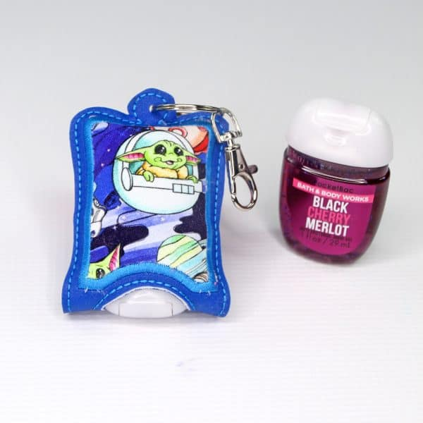 Green baby alien hand sanitizer case with attached swivel clip.