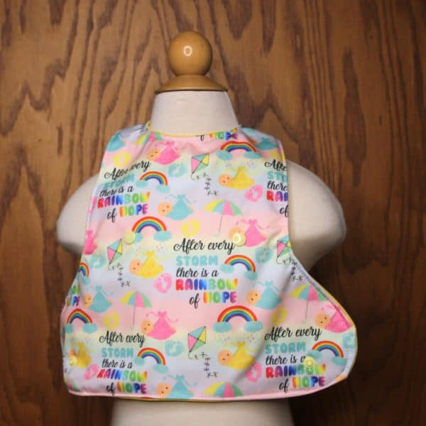 Rainbow baby designs on an adorable baby bib crumb catcher that keeps baby clean during mealtime.