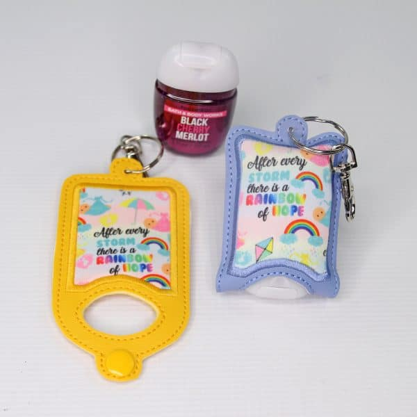 Rainbow baby hand sanitizer case with a swivel clip to attach to your diaper bag.