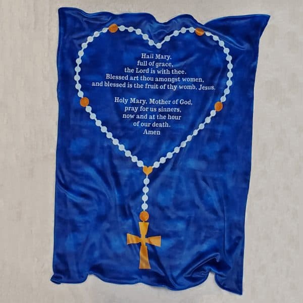 This soft Hail Mary rosary blanket is the perfect baby gift but also makes a wonderful lap blanket for an adult.