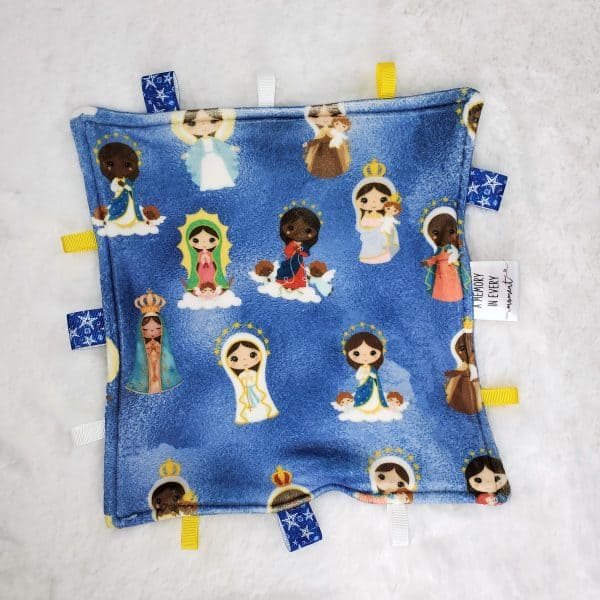 Hail Mary prayer sensory blanket back side featuring the various versions of the Blessed Mother such as Our Lady of Lourdes.
