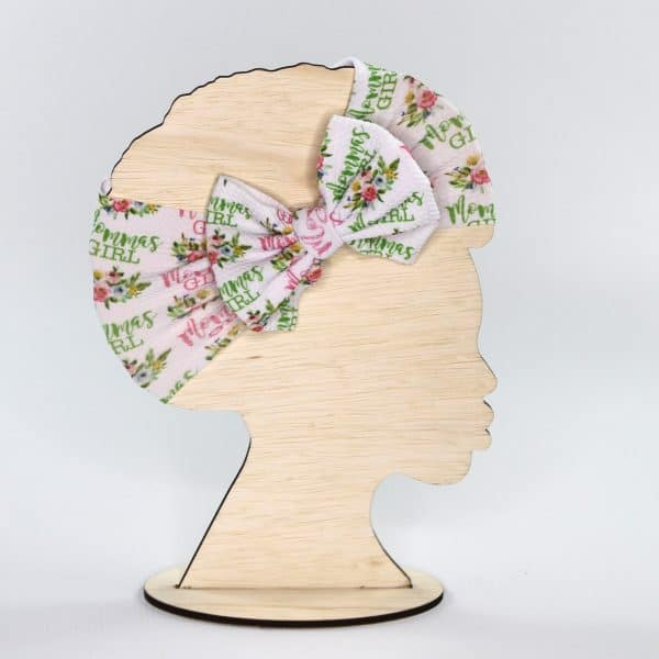 The momma's girl headwrap bow in pink and green with cute little flowers is a wonderful gift idea for any little girl.