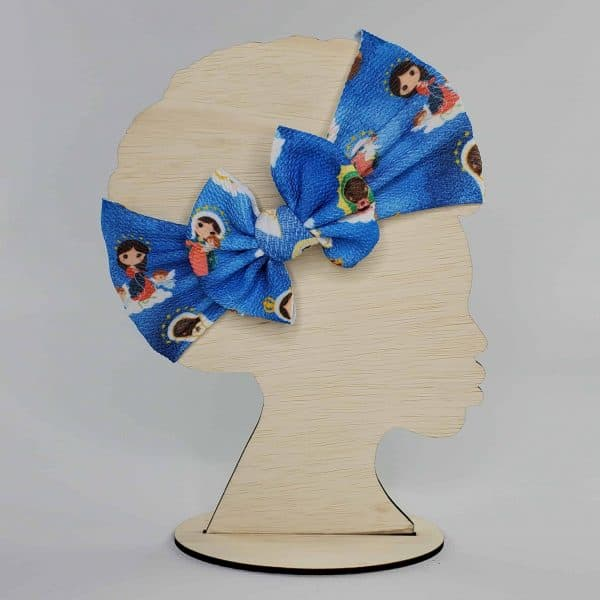 A Blessed Mary Headwrap Bow featuring Mary in various versions such as Our Lady of Fatima and Our Lady of Lourdes.