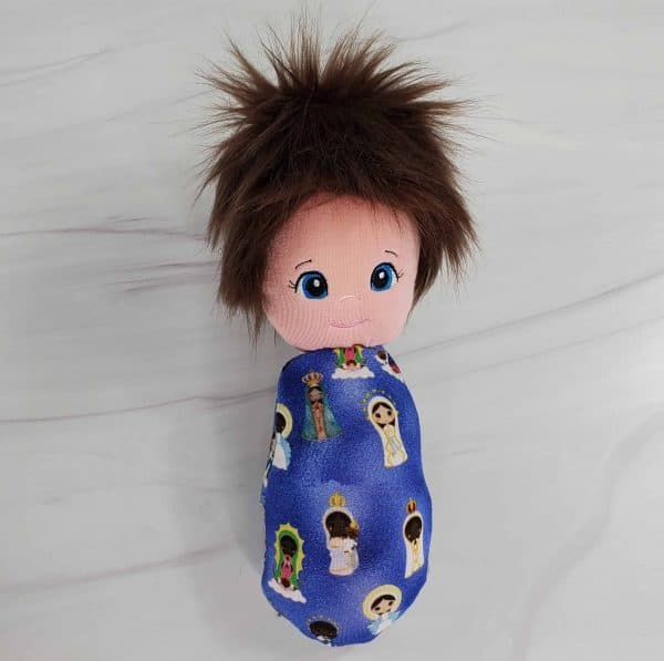 A Blessed Mary swaddle doll with exclusive fabric from Kidderbug Kreations featuring Mary in both black versions as well as white versions.