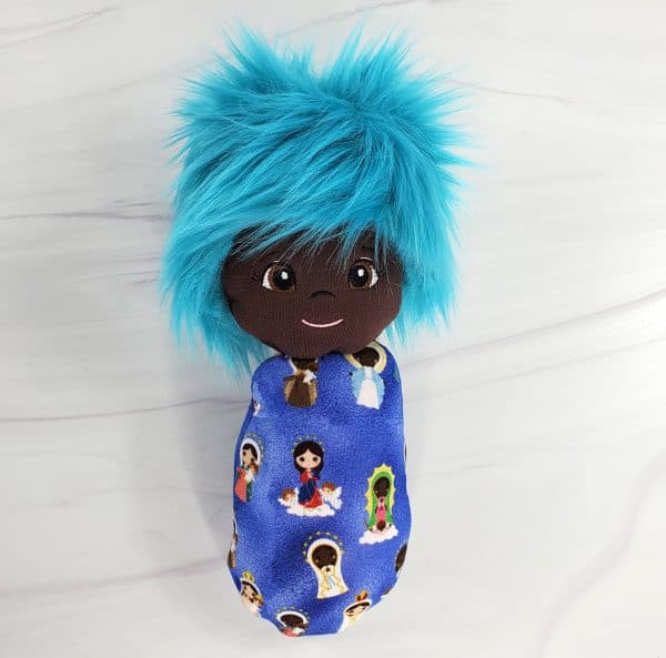Black skinned, blue haired Mary swaddle doll from Kidderbug Kreations.