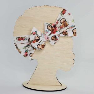 A St. Therese Headwrap Bow featuring St. Therese with lots of roses. Perfect gift for little girls.
