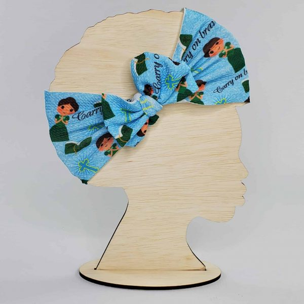 A St. Zelie Headwrap Bow featuring Saint Zelie Martin with 'Carry on bravely.'