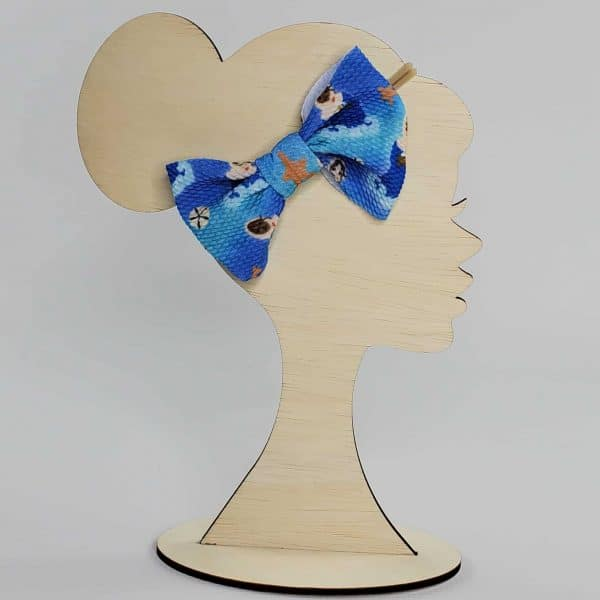 A Stella Maris, or Mary Star of the Sea Headband Bow featuring Mary in black versions as well as white versions with starfish and sand dollars.