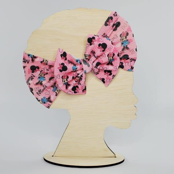 Headwrap bow featuring a little girl mouse in pink and aqua.