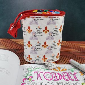 A St. Joan of Arc stand up slide down bag for storing markers, sewing supplies, or other fun things.