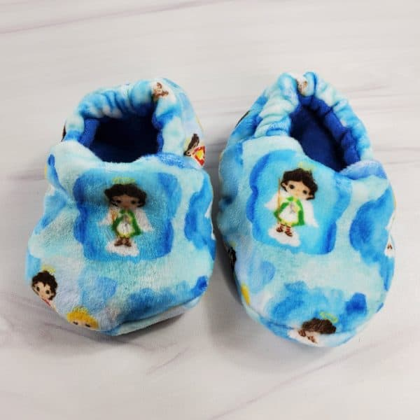 Cute blue baby booties featuring the St. Michael, St. Gabriel, and St. Raphael the archangels.