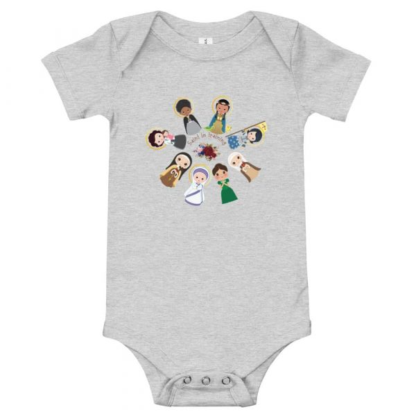 Heather colored baby bodysuit featuring female saints and 'Saint in training.'
