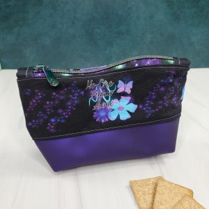 """Purple reusable snack bag-alzheimer's with """"No one fights alone"""" written on it as well as butterflies and flowers."""