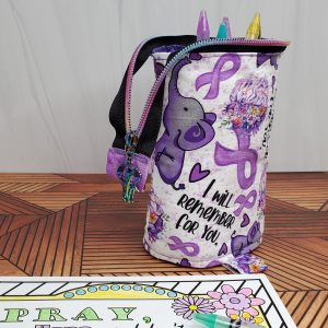"""A pen/marker stand-up bag featuring Alzheimer's awareness fabric with elephants, purple ribbons, and """"I will remember for you."""""""